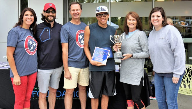 Emily Garner, Mark Taylor, Frank McMeen, Arzez-Dante' Williams (first place overall male, 5K), Gina Piercey, Beth Koffman at the Tennessee Rhythm Run.