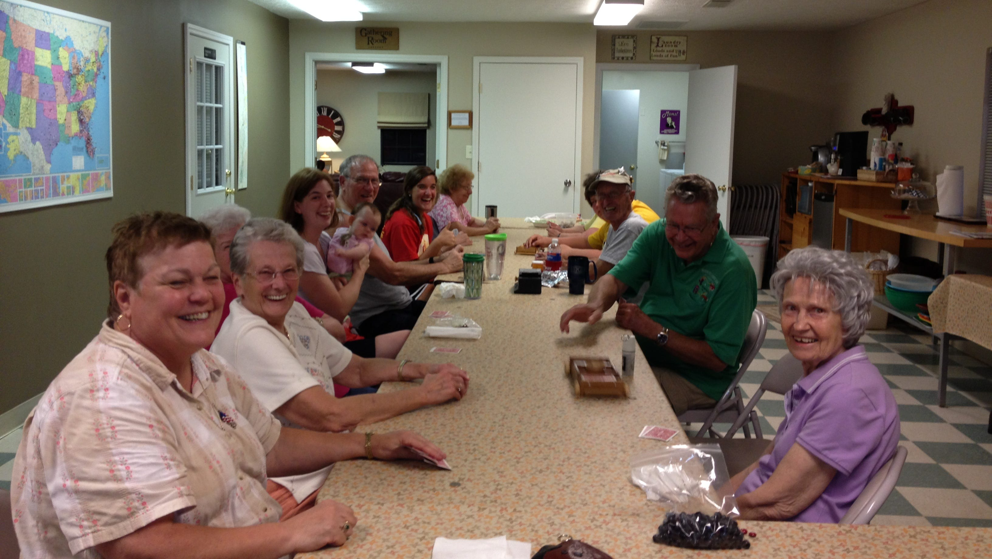 Guests congregate for one of the regular card games in the community building.