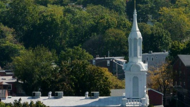 A view looking East from the Walkway Over the Hudson. Mt. Carmel Church foreground, Poughkeepsie Journal building center left, First Congregational Church center right, First Evangelical Lutheran Church far right.