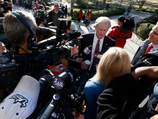 Joe Rondone/ DemocratFSU President John Thrasher speaks with reporters outside of Strozier Library on Friday Nov. 21, 2014.