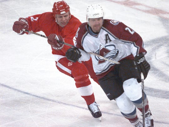 Red Wing Viacheslav Fetisov tries to slow down Avalanche