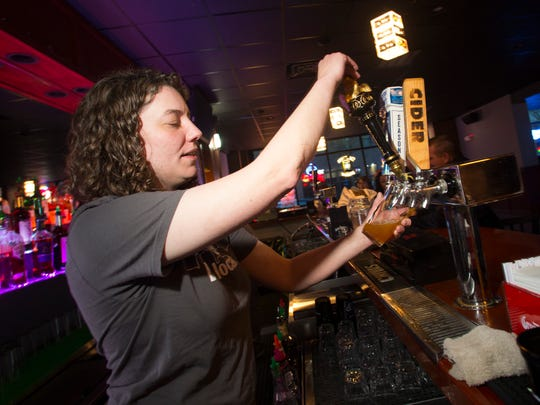 Anne Mathey pours a beer for a customer at the Drake Relays Party featuring Bonne Finken & The Collective and Peace, Love, and Stuff on April 23rd, 2015 at Lefty's Live Music in Des Moines.