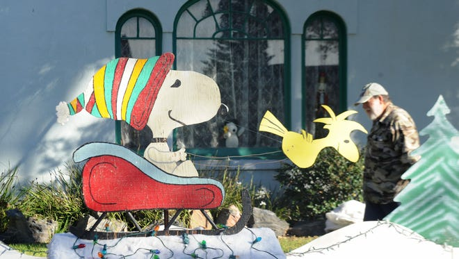 """Steve Fleischer decorates his yard with """"Peanuts"""" characters for Christmas Tree Lane in Oxnard two years ago."""
