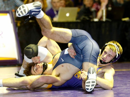 Northern Iowa's Jay Schwarm scrambles for control of