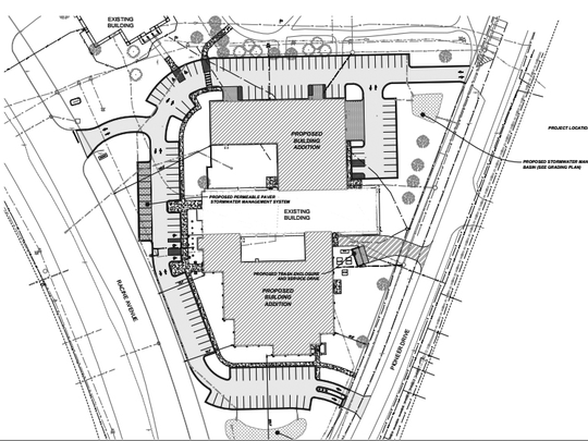 The layout of the proposed new Muskego City Hall and Police Department shows the current city hall in the center that would become part of the new police station. Police additions would be built onto it. Parking would extend around the southern tip of the building. The entrance would be near the center of the new combined facility.