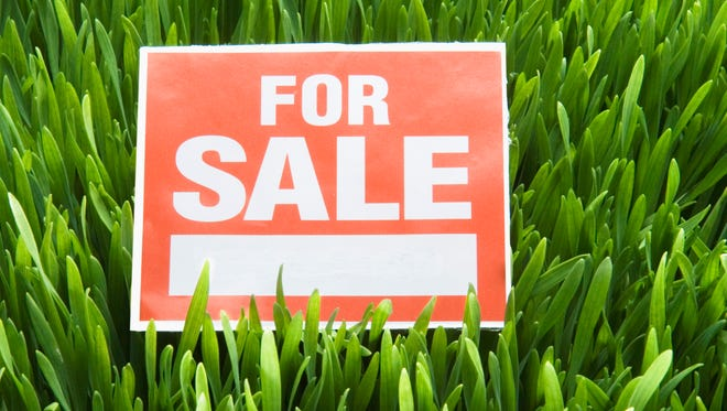 For Sale Sign on Grass