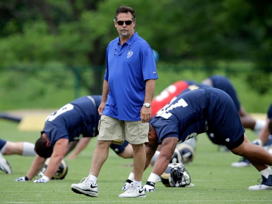 St. Louis Rams head coach Jeff Fisher watches his team during an organized team activity at the NFL football team's practice facility Thursday, June 5, 2014, in St. Louis. (AP Photo/Jeff Roberson)