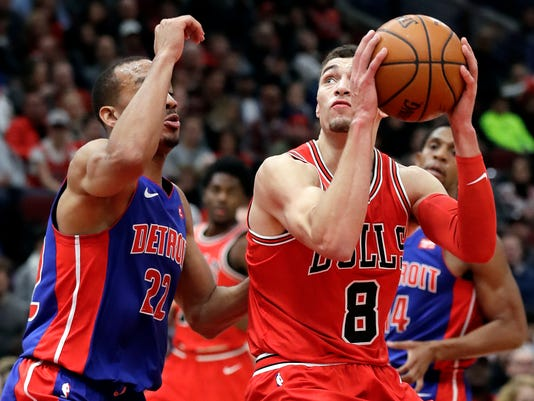 Chicago Bulls guard Zach LaVine, right, looks to the basket as Detroit Pistons guard Avery Bradley defends during the second half of an NBA basketball game Saturday, Jan. 13, 2018, in Chicago. (AP Photo/Nam Y. Huh)