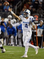 Memphis quarterback Riley Ferguson throws during the first half of an NCAA college football game against Connecticut, Friday, Oct. 6, 2017, in East Hartford, Connecticut.