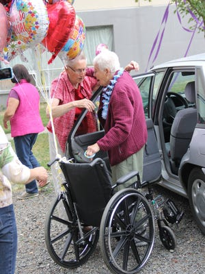 Verna Scharbach and Sister Angela Meister embrace as Scharbach arrives at Mission Benedict on Friday, June 22, 2018.