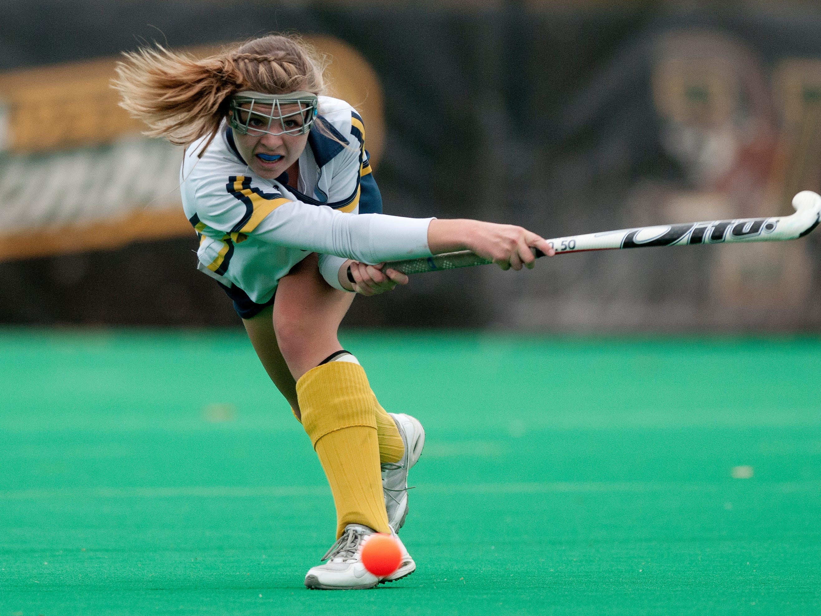 Essex's Kathleen Young hits the ball down the field during the Division I field hockey state championship against Hartford and the University of Vermont's Moulton-Winder Field in November.
