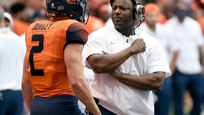 Syracuse coach Dino Babers talks with quarterback Eric Dungey (2) during an NCAA college football game against Connecticut on Saturday, Sept. 22, 2018, in Syracuse, N.Y. (Dennis Nett/The Post-Standard via AP)