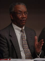 Dr. Roland Porter speaks during a 2009 health care roundtable discussion held in Harvey Auditorium at Union University.