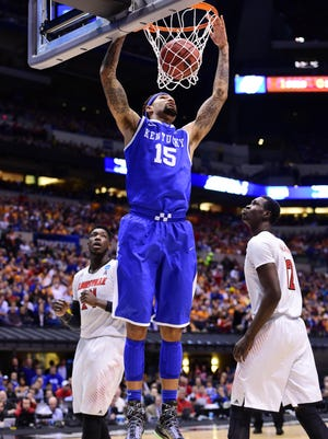 Kentucky Wildcats forward Willie Cauley-Stein (15) dunks against the Louisville Cardinals in the first half in the semifinals of the midwest regional of the 2014 NCAA Mens Basketball Championship tournament.
