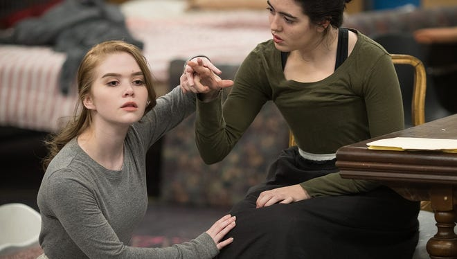 "University of Wisconsin-Stevens Point theatre students Karley Scheidegger, as Helen Keller, and Elena Cramer, as Annie Sullivan, rehearse a scene from ""The Miracle Worker."" The drama will be staged by the Department of Theatre and Dance March 3-5 and 9-11."