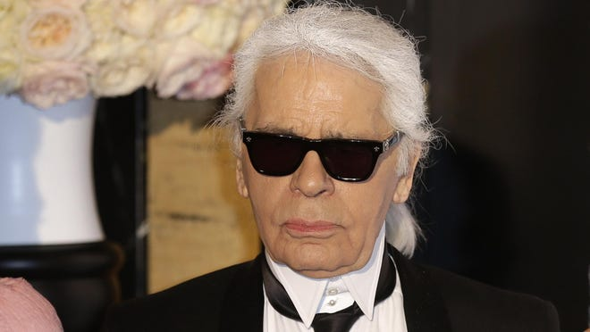 Karl Lagerfeld, Chanel's iconic couturier whose accomplished designs as well as trademark white ponytail, high starched collars and dark enigmatic glasses dominated high fashion for the last 50 years, has died. He was around 85 years old.