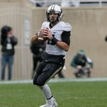 Purdue quarterback David Blough (11) looks downfield during the second half of an NCAA college football game against Michigan State, Saturday, Oct. 3, 2015, in East Lansing, Mich. (AP Photo/Carlos Osorio)