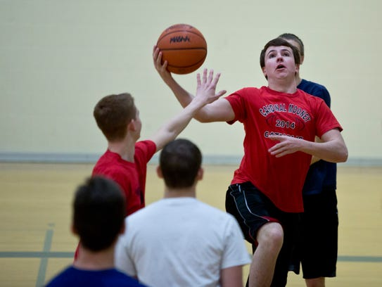 Kevin Krajewski, 18, goes for a shot while playing