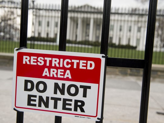 A security fence is seen around the perimeter of the