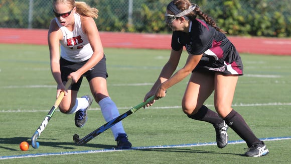 Rye's Fusine Govaert moves the ball in front of Scarsdale's