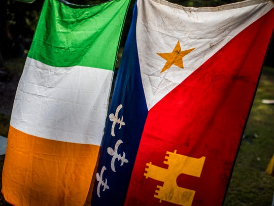 Irish and Acadian flags hang side-by-side.