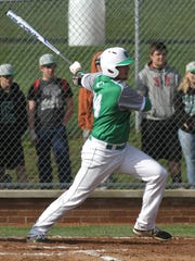 Clear Fork's Gavin Bailey swings at the ball while