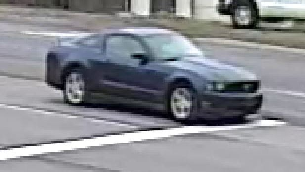 Michigan State Police said this surveillance photograph shows the blue Ford Mustang a man used to flee the PNC Bank branch at 8130 W. Grand River Ave. after a robbery April 4, 2016.