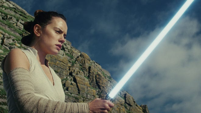 Galactic adversaries Rey (Daisy Ridley) and Kylo Ren (Adam Driver) were last seen facing off in bitter battle.    photos by Lucasfilm Rey (Daisy Ridley) wields a mean lightsaber in 'Star Wars: The Last Jedi.'