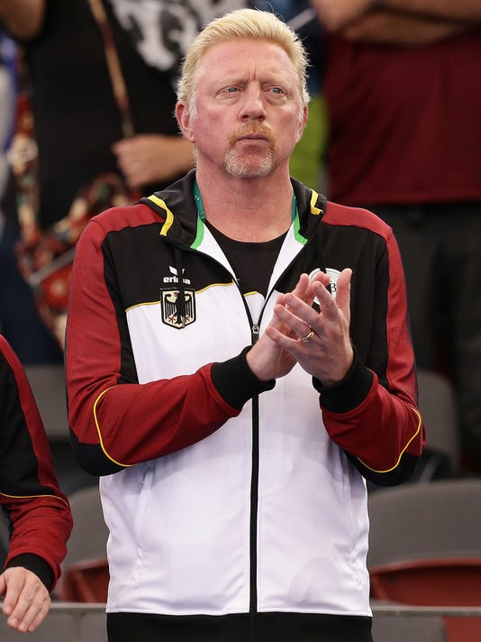 Boris Becker of the German team reacts during play at the Davis Cup World Group first round between Australia and Germany in Brisbane, Australia, Friday, Feb. 2, 2018. (AP Photo/Tertius Pickard)