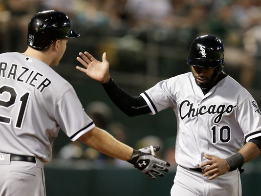 Chicago White Sox's Austin Jackson, right, celebrates with Todd Frazier (21) after scoring against the Oakland Athletics during the third inning of a baseball game Wednesday, April 6, 2016, in Oakland, Calif. Jackson scored on a sacrifice fly by sacrifice fly by Jimmy Rollins. (AP Photo/Ben Margot)