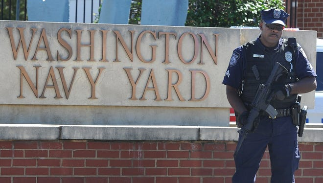 A guard stands outside the gate to the Washington Navy Yard on Sept. 17 in Washington, D.C.
