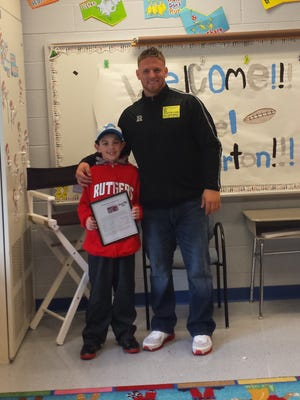 """NFL draft pick Michael Burton poses with Anthony Nasisi, left, a 4th grade student at Benedict A. Cucinella School, who was recognized for an essay he wrote about the football play for NJ Scoop's """"Celebrate New Jersey"""" contest."""