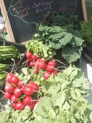 Radishes and greens are some of the fresh produce available