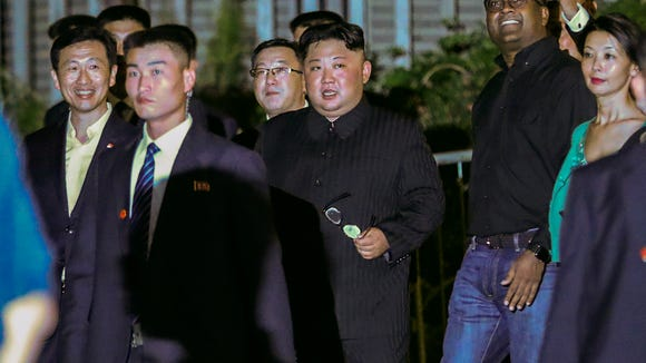 North Korea leader Kim Jong Un, center, is escorted