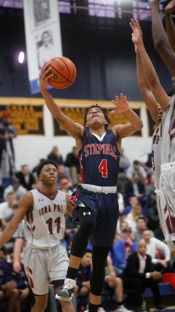 Stepinac's RJ Davis (4) shoots during the game against