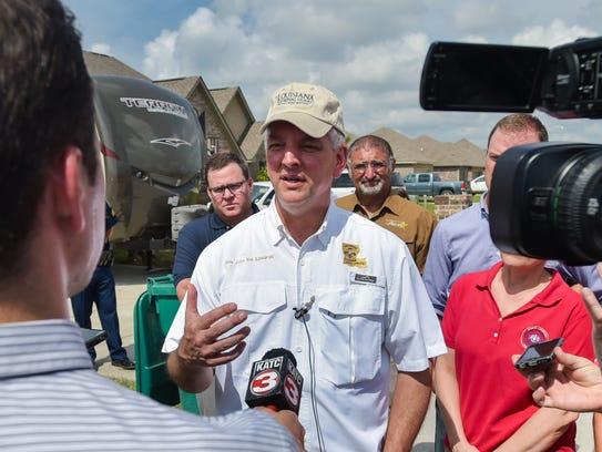 Gov. John Bel Edwards speaks with media after  meeting