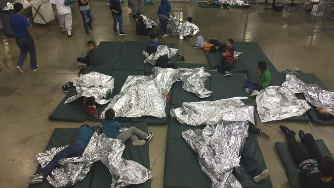 People who illegally crossed the U.S.-Mexico border are held at the Central Processing Center in McAllen, Texas on May 23, 2018.