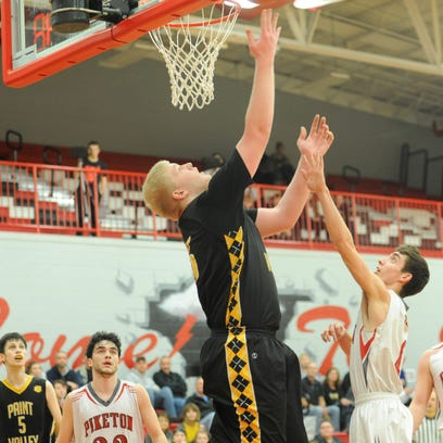Paint Valley's Dylan Swingle scores during the third