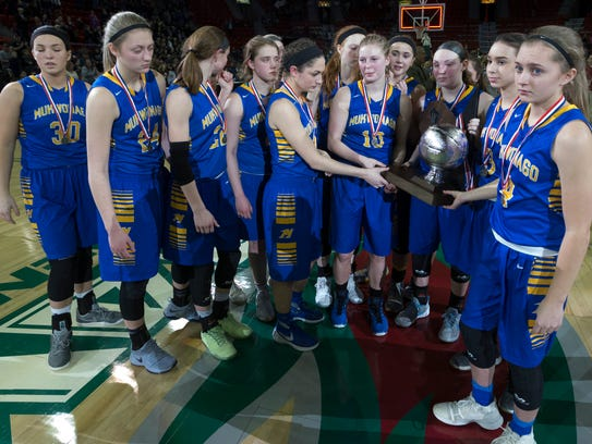 Mukwonago basketball players wear somber faces as they