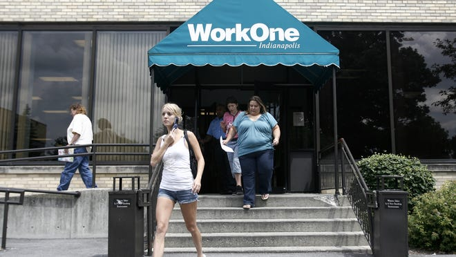 A number of people exit the WorkOne unemployment office on Monday, July 27, 2009.