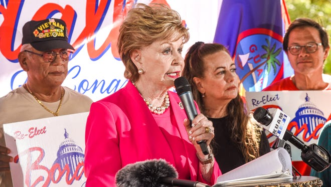 Del. Madeleine Z. Bordallo, is flanked by her daughter, Deborah Bordallo, and other supporters, as she announces her intention to seek re-election as Guam's representative in Washington, D.C., during a gathering at the Plaza de Espana in Hagåtña on Tuesday, Feb. 20, 2018.