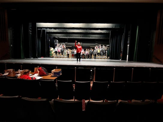 """Cast members from the musical """"Grease"""" rehearse the"""