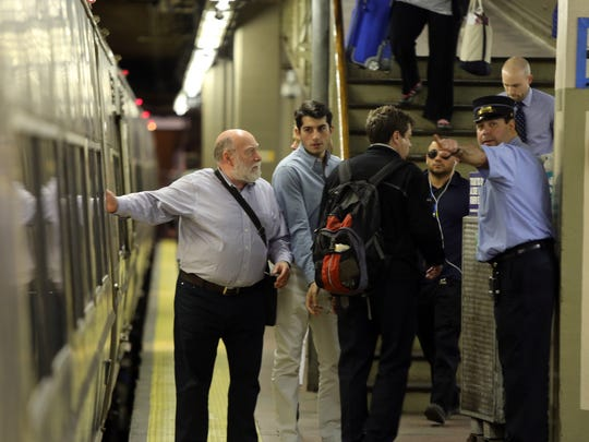 Metro North passengers check with the conductor before