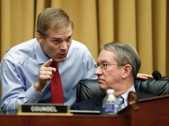 House Judiciary Committee Chairman Bob Goodlatte, R-Va., right, and committee member Rep. Jim Jordan, R-Ohio, talk as FBI Director Christopher Wray testifies during a House Judiciary hearing on Capitol Hill in Washington, Thursday, Dec. 7, 2017, on oversight of the Federal Bureau of Investigation. (AP Photo/Carolyn Kaster)