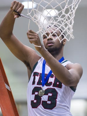 Arsenal Tech High School senior Justin Parker (33) celebrates winning the 2014 Indianapolis City Boys Basketball Tournament at Arsenal Technical High School Thursday, Jan. 30, 2014. Arsenal Tech defeated Cathedral 66-58.