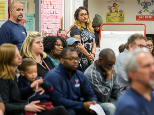 Dozens of neighborhood residents listen as Wilmington Police Chief Bobby Cummings speaks at the Cool Spring Neighborhood Association meeting at Lewis Dual Language Elementary School on Tuesday night.