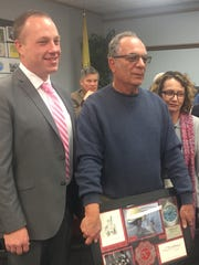 Rick Marino, (center) senior communications technician, was honored by the Vineland school board Jan. 10, which was his last meeting before his retirement. Also pictured, BOE President Jeff Bordley (left) and Elaine Greenberg, the district's archivist (right).