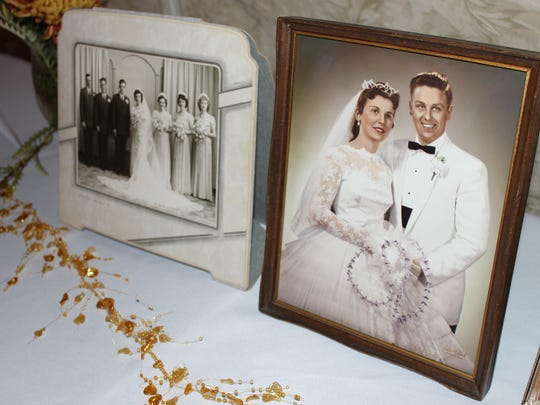Wedding photos were displayed during a dinner on Oct. 19 at Our Lady of Peace Catholic Church in Marshfield that honored couples married more than 50 years.