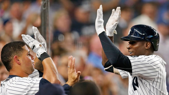 New York Yankees' Gary Sanchez, left, congratulates Didi Gregorius after Gregarious hit a seventh-inning, pinch-hit solo home run in a baseball game in New York, Tuesday, Sept. 13, 2016.