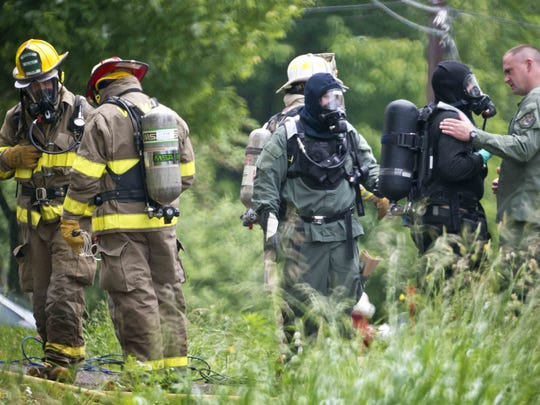 Members of the Vermont State Police, the state hazmat response team and the Underhill Jericho Fire Department investigagte a possible meth lab at 100 Sunnyview Drive in Jericho on Wednesday, June 18, 2014.